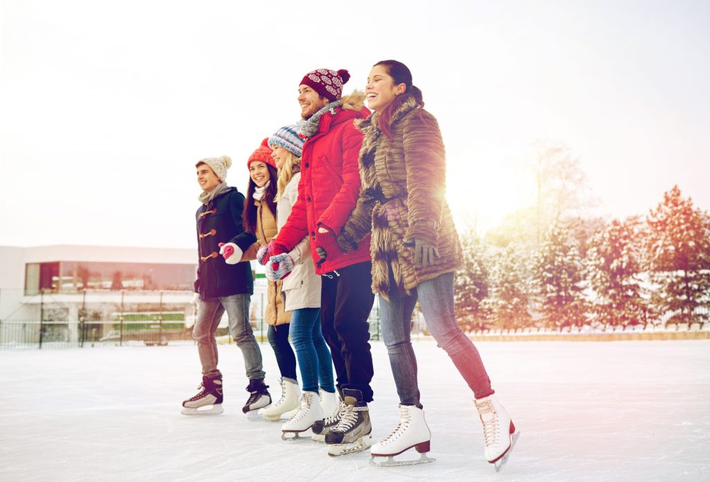 friends skating on an outdoor rink