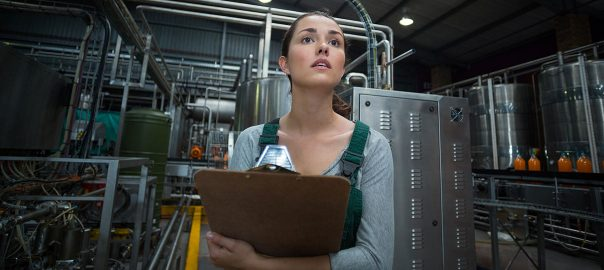 Woman performing an ammonia refrigeration inspection